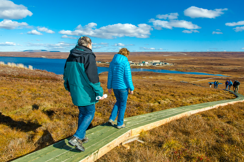 """Donie Bret-Harte, left,, associate science director at UAF's Toolik Field Station, explains some of the research efforts underway near the arctic facility with U.S. Senator Lisa Murkowski during a brief tour in Sept. 2013.  <div class=""""ss-paypal-button"""">Filename: AAR-13-3929-377.jpg</div><div class=""""ss-paypal-button-end""""></div>"""