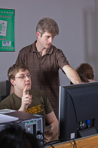 Faculty member John Quan provides assistance to one of his students in the Chapman Building ASSERT lab.  Filename: AAR-12-3272-26.jpg