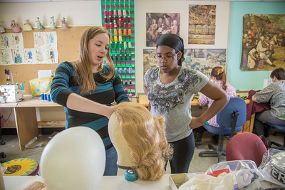 """Assistant professor Bethany Marx (left) works with her student """"wig master"""" Erlee Hjellen in the costume shop during preparations for Theatre UAF's spring 2014 production of """"Tartuffe.""""  Filename: AAR-14-4104-220.jpg"""