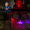"Physics major Michael Succone experiments with light from a laser as its being scattered by clouds of condensation inside an aquarium in a Reichardt Building lab.  <div class=""ss-paypal-button"">Filename: AAR-13-4009-7.jpg</div><div class=""ss-paypal-button-end"" style=""""></div>"