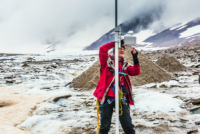 Professor Regine Hock, a glaciologist with UAF's Geophysical Institute, measure the depth of the ice near the toe of the Jarvis Glacier in the eastern Alaska Range.  Filename: AAR-14-4256-457.jpg