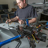 "Technician Michael Cook works on one of the unmanned aerial vehicles in UAF's Alaska Center for Unmanned Aircraft Systems Integration (ACUASI) shop in south Fairbanks.  <div class=""ss-paypal-button"">Filename: AAR-13-4026-17.jpg</div><div class=""ss-paypal-button-end""></div>"