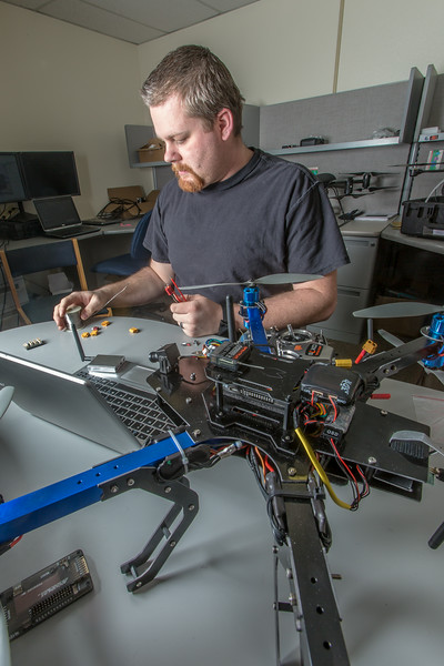 """Technician Michael Cook works on one of the unmanned aerial vehicles in UAF's Alaska Center for Unmanned Aircraft Systems Integration (ACUASI) shop in south Fairbanks.  <div class=""""ss-paypal-button"""">Filename: AAR-13-4026-17.jpg</div><div class=""""ss-paypal-button-end""""></div>"""