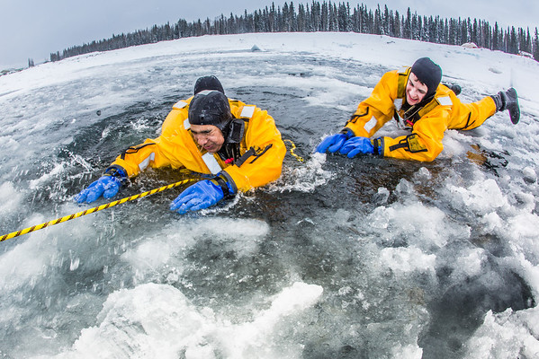 """Student firefighters practice cold-water rescue techniques at a pond near the Fairbanks campus.  <div class=""""ss-paypal-button"""">Filename: AAR-13-3797-35.jpg</div><div class=""""ss-paypal-button-end"""" style=""""""""></div>"""