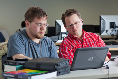 Assistant professor Thane Magelky, right, works with freshman James Griffin in his drafting technology class in the CTC center downtown.  Filename: AAR-11-3221-44.jpg
