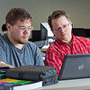 "Assistant professor Thane Magelky, right, works with freshman James Griffin in his drafting technology class in the CTC center downtown.  <div class=""ss-paypal-button"">Filename: AAR-11-3221-44.jpg</div><div class=""ss-paypal-button-end"" style=""""></div>"
