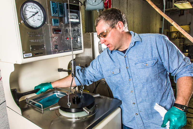 """Research professional Matt Bray studies pressurized petroleum samples in a Duckering Building rock mechanics lab.  <div class=""""ss-paypal-button"""">Filename: AAR-13-3919-25.jpg</div><div class=""""ss-paypal-button-end"""" style=""""""""></div>"""