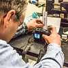 "Research professional Matt Bray takes detailed macro photos of breakage patterns in concrete samples in a Duckering Building rock mechanics lab.  <div class=""ss-paypal-button"">Filename: AAR-13-3919-14.jpg</div><div class=""ss-paypal-button-end"" style=""""></div>"