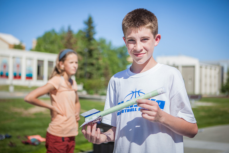 "Middle school students try various rocket designs outdoors during the Alaska Summer Research Academy.  <div class=""ss-paypal-button"">Filename: AAR-13-3862-16.jpg</div><div class=""ss-paypal-button-end"" style=""""></div>"