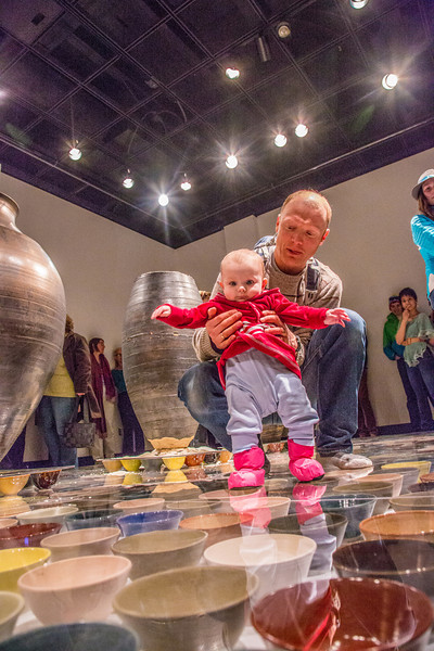 """Patrons of all ages walked around on the ceramic artwork produced by Ian Wilkinson for his BFA thesis during the opening of his show in the gallery in the UAF Fine Arts Complex.  <div class=""""ss-paypal-button"""">Filename: AAR-13-3780-380.jpg</div><div class=""""ss-paypal-button-end"""" style=""""""""></div>"""