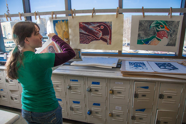 """Senior foreign languages major Lindsey Miller spent lots of time in the printmaking studio in the UAF Fine Arts Complex.  <div class=""""ss-paypal-button"""">Filename: AAR-12-3353-19.jpg</div><div class=""""ss-paypal-button-end"""" style=""""""""></div>"""