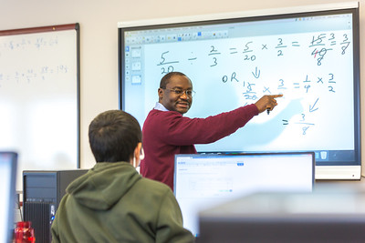 UAF Chukchi Campus Assistant Professor of Developmental Math Kelechukwu Alu works one-on-one with a student during a morning class at the Alaska Technical Center in Kotzebue.  Filename: AAR-16-4863-356.jpg