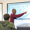 "UAF Chukchi Campus Assistant Professor of Developmental Math Kelechukwu Alu works one-on-one with a student during a morning class at the Alaska Technical Center in Kotzebue.  <div class=""ss-paypal-button"">Filename: AAR-16-4863-356.jpg</div><div class=""ss-paypal-button-end""></div>"