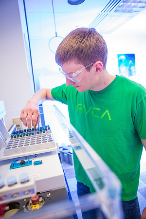 Chemistry major James Micah Simmerman completes a procedure in a Reichardt Building lab.  Filename: AAR-12-3598-118.jpg