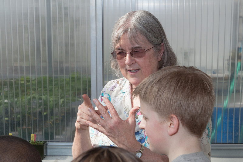 """Professor Pat Holloway with UAF's Agricultural and Forestry Experiment Station leads a group of Fairbanks school children through a tour of the new SNRAS greenhouse on Research Day 2012.  <div class=""""ss-paypal-button"""">Filename: AAR-12-3364-02.jpg</div><div class=""""ss-paypal-button-end"""" style=""""""""></div>"""