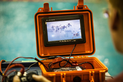 Middle school students jump right in the water to be photographed at a remotely operated vehicle submersed inside the water during their ROV trials at the Alaska Summer Research Academy.  Filename: AAR-13-3861-73.jpg