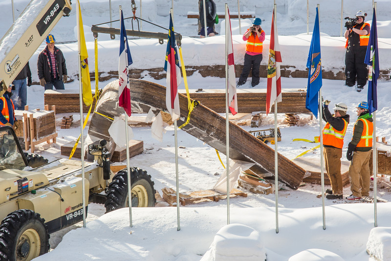 """Engineering students and volunteers from GHEMM Company raise the 2013 ice arch in Cornerstone Plaza on the Fairbanks campus. Students this year built the structure out of a mixture of ice and sawdust, which is many times stronger than concrete.  <div class=""""ss-paypal-button"""">Filename: AAR-13-3736-23.jpg</div><div class=""""ss-paypal-button-end"""" style=""""""""></div>"""