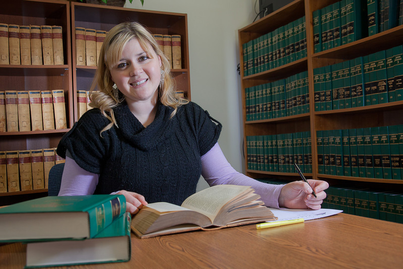 """Tara Bourdeau conducts some research for her paralegal studies class at CTC's law library.  <div class=""""ss-paypal-button"""">Filename: AAR-11-3225-25.jpg</div><div class=""""ss-paypal-button-end"""" style=""""""""></div>"""