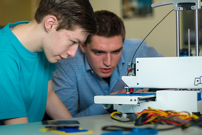Stephen Ramirez, left, and Daniel Dougherty watch the progress on their project during an open work session in UAF's Community and Technical College's 3-D print lab in downtown Fairbanks.  Filename: AAR-16-4857-020.jpg
