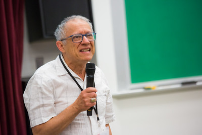Linguistics professor Lawrence Kaplan welcomes the 2016 Collaborative Language Research conference at the Schaible Auditorium on the Fairbanks campus.  Filename: AAR-16-4919-13.jpg