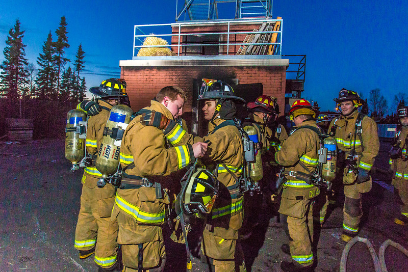 """Student fire fighters Spencer McLean, left, and John Jones prepare to enter a burning building as part of a live training drill at the Fairbanks Fire Training Center.  <div class=""""ss-paypal-button"""">Filename: AAR-13-3978-30.jpg</div><div class=""""ss-paypal-button-end"""" style=""""""""></div>"""
