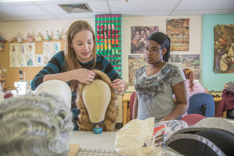 "Assistant professor Bethany Marx (left) works with her student ""wig master"" Erlee Hjellen in the costume shop during preparations for Theatre UAF's spring 2014 production of ""Tartuffe.""  <div class=""ss-paypal-button"">Filename: AAR-14-4104-216.jpg</div><div class=""ss-paypal-button-end"" style=""""></div>"