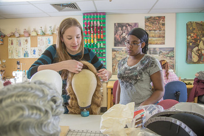 "Assistant professor Bethany Marx (left) works with her student ""wig master"" Erlee Hjellen in the costume shop during preparations for Theatre UAF's spring 2014 production of ""Tartuffe.""  Filename: AAR-14-4104-216.jpg"
