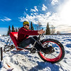 """Mechanical engineering major Neil Gotschall demonstrates the fat tire ski bike he and two partners designed and built for paraplegic users as their spring 2016 senior design project. The bike is powered by pushing and pulling on the handles.  <div class=""""ss-paypal-button"""">Filename: AAR-16-4856-18.jpg</div><div class=""""ss-paypal-button-end""""></div>"""