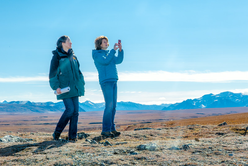 "U.S. Senator Lisa Murkowski snaps some pictures with her iPhone during her brief visit to IAB's Toolik Field Station on Alaska's North Slope in Sept, 2013. Leading Murkowski on her tour was Toolik associate science director Donie Bret-Harte.  <div class=""ss-paypal-button"">Filename: AAR-13-3929-363.jpg</div><div class=""ss-paypal-button-end""></div>"