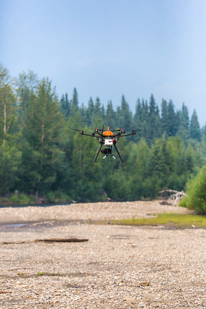 An unmanned aerial vehicle (UAV) stands ready to collect video of important king salmon spawning habitat along a popular stretch of the upper Chena River about 40 miles northeast of Fairbanks. The project was a collaboration between the Alaska Center for Unmanned Aircraft Systems Integration (ACUASI) and the U.S. Fish and Wildlife Service.  Filename: AAR-15-4593-269.jpg