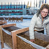 "Civil engineering major Katrina Monta levels out sawdust mixed with water that when frozen, hardens into a substance many times stronger than concrete. Katrina and others are hard at work on this year's ice arch, scheduled for completion Feb. 20.  <div class=""ss-paypal-button"">Filename: AAR-13-3718-26.jpg</div><div class=""ss-paypal-button-end"" style=""""></div>"