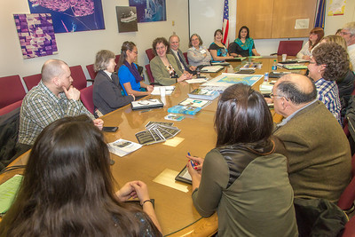 A group of students from rural Alaska attending a weeklong seminar on Understanding the Legislative Process in Juneau, meets with Susan Bell, commissioner of the Alaska Department of Commerce and Economic Development in a state office building conference room.  Filename: AAR-14-4054-41.jpg
