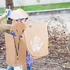 "Zarah Helms-Leslie wears cardboard armor and weapons during sculpture class at UAF's Visual Arts Academy.  <div class=""ss-paypal-button"">Filename: AAR-12-3427-39.jpg</div><div class=""ss-paypal-button-end"" style=""""></div>"