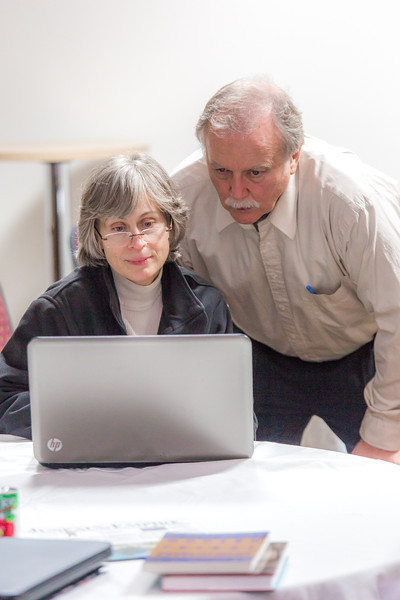 """Associate Professor Mike Davis with UAF's Alaska Native Studies and Rural Development program works with rural development major Triena Slattern from Anchorage during an evening work session as part of their weeklong seminar on Understanding the Legislative Process in the state capital of Juneau.  <div class=""""ss-paypal-button"""">Filename: AAR-14-4054-379.jpg</div><div class=""""ss-paypal-button-end"""" style=""""""""></div>"""