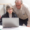 "Associate Professor Mike Davis with UAF's Alaska Native Studies and Rural Development program works with rural development major Triena Slattern from Anchorage during an evening work session as part of their weeklong seminar on Understanding the Legislative Process in the state capital of Juneau.  <div class=""ss-paypal-button"">Filename: AAR-14-4054-379.jpg</div><div class=""ss-paypal-button-end"" style=""""></div>"