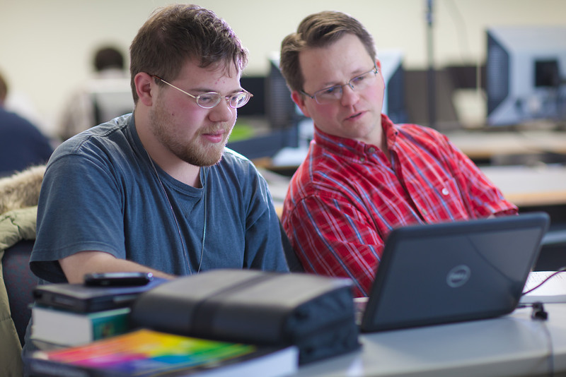 "Assistant professor Thane Magelky, right, works with freshman James Griffin in his drafting technology class in the CTC center downtown.  <div class=""ss-paypal-button"">Filename: AAR-11-3221-38.jpg</div><div class=""ss-paypal-button-end"" style=""""></div>"