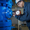 "Stefan Weingarth tightens a pressure gauge on the oil field well head at CTC's process technology facility on Van Horn Road.  <div class=""ss-paypal-button"">Filename: AAR-11-3230-006.jpg</div><div class=""ss-paypal-button-end"" style=""""></div>"