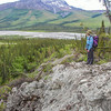 "Associate professor Margaret Darrow pauses as she hikes down one of a series of frozen debris lobes which have appeared along the Dietrich River valley in the southern Brooks Range about 225 miles north of Fairbanks. Darrow and a team of state geologists are investigating ways to slow down or step the movement of the lobes, which could threaten the Dalton Highway and the nearby trans-Alaska pipeline.  <div class=""ss-paypal-button"">Filename: AAR-14-4214-537.jpg</div><div class=""ss-paypal-button-end""></div>"