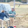 "Pilot Mike Cook retreives the payload after the initial flight of the Aeryon Scout quadcopter at UAF's Large Animal Research Station.  <div class=""ss-paypal-button"">Filename: AAR-14-4172-134.jpg</div><div class=""ss-paypal-button-end""></div>"