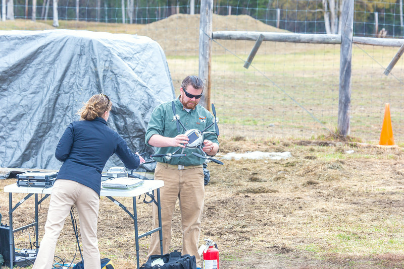 """Pilot Mike Cook retreives the payload after the initial flight of the Aeryon Scout quadcopter at UAF's Large Animal Research Station.  <div class=""""ss-paypal-button"""">Filename: AAR-14-4172-134.jpg</div><div class=""""ss-paypal-button-end""""></div>"""