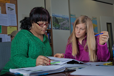 Lauren Divine, right, a tutor with UAF's Student Support Services, works with Sante Lee-Sonkoh during a session in the SSS study lounge in the Gruening Building.  Filename: AAR-12-3285-065.jpg