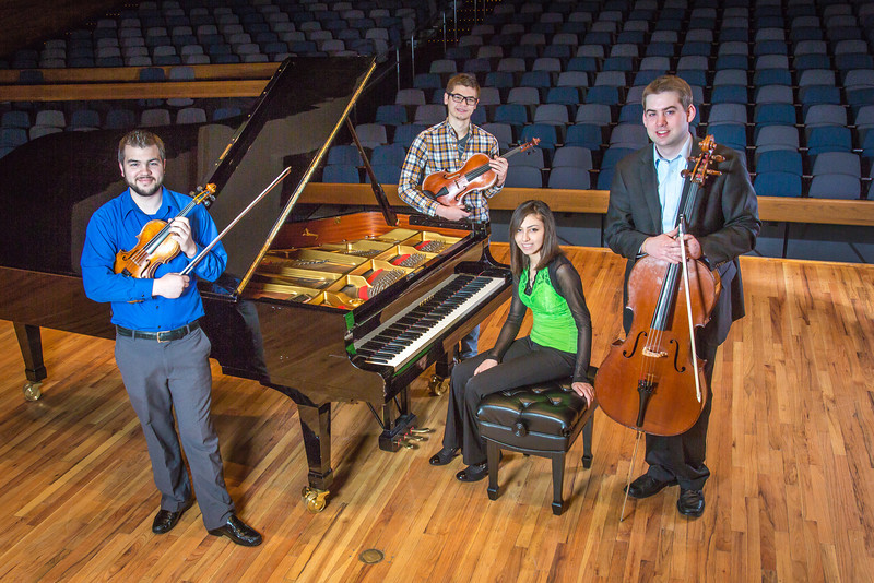 """From left to right, Franz Felkl, Trevor Adams, Ani Gyulamiryan and Bryant Hopkins performed as a quartet during the 2013 UAF Scholarship Breakfast.  <div class=""""ss-paypal-button"""">Filename: AAR-13-3764-06.jpg</div><div class=""""ss-paypal-button-end"""" style=""""""""></div>"""
