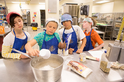 Café Tween students receive hands on training in the culinary arts as they prepare Indian style cuisine at the Community and Technical College's kitchen.  Filename: AAR-12-3434-18.jpg