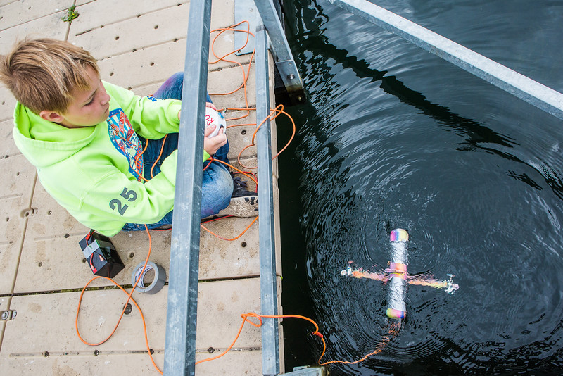 "Alaska Summer Research Academy participants test their remotely operated underwater vehicles at the Chena Lake Recreation Area on Thursday, July 28.  <div class=""ss-paypal-button"">Filename: AAR-16-4943-131.jpg</div><div class=""ss-paypal-button-end""></div>"