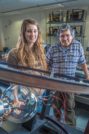 Physics major Haley Nelson, left, and Stanley Edwin relax after class in a Reichardt Building lab.  Filename: AAR-13-4009-105.jpg