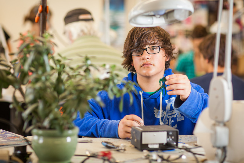 """Using metalsmithing techniques, students at the Summer Visual Art Academy work on their projects creating artwork in copper, brass and silver.  <div class=""""ss-paypal-button"""">Filename: AAR-13-3860-63.jpg</div><div class=""""ss-paypal-button-end"""" style=""""""""></div>"""