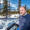 "Research associate professor Javier Fochesatto, helps set up a remote meteorological station on a hillside near the Black Rapids Lodge, about 150 miles southeast of Fairbanks. The station will record wind speed and direction, as well as temperatures at different altitudes.  <div class=""ss-paypal-button"">Filename: AAR-13-3843-98.jpg</div><div class=""ss-paypal-button-end"" style=""""></div>"