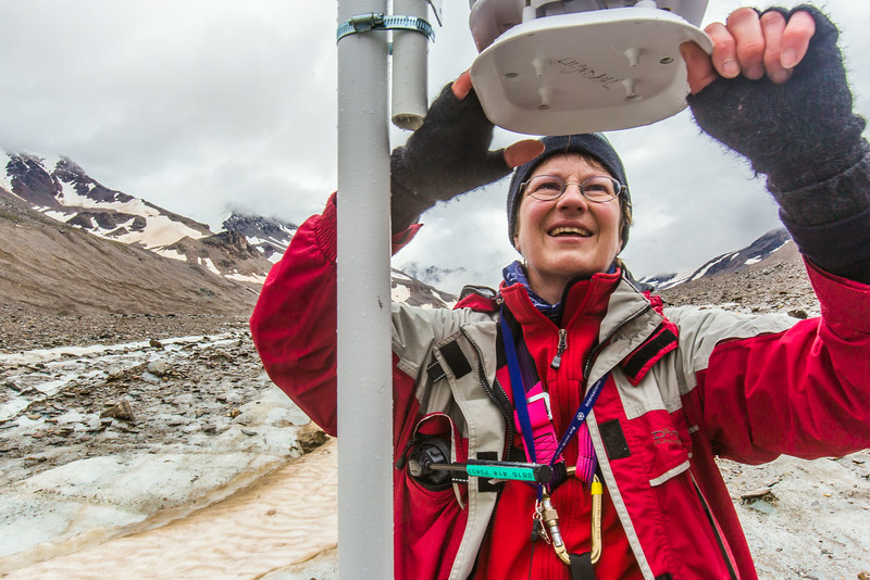"""Professor Regine Hock, a glaciologist with UAF's Geophysical Institute, measure the depth of the ice near the toe of the Jarvis Glacier in the eastern Alaska Range.  <div class=""""ss-paypal-button"""">Filename: AAR-14-4256-437.jpg</div><div class=""""ss-paypal-button-end""""></div>"""