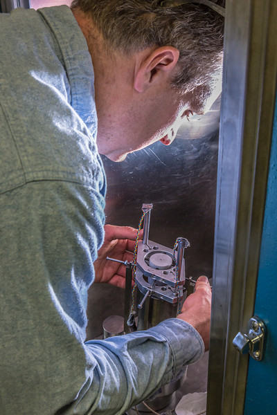 """Research professional Matt Bray prepares concrete samples for testing under extreme pressure in a Duckering Building rock mechanics lab.  <div class=""""ss-paypal-button"""">Filename: AAR-13-3919-85.jpg</div><div class=""""ss-paypal-button-end"""" style=""""""""></div>"""