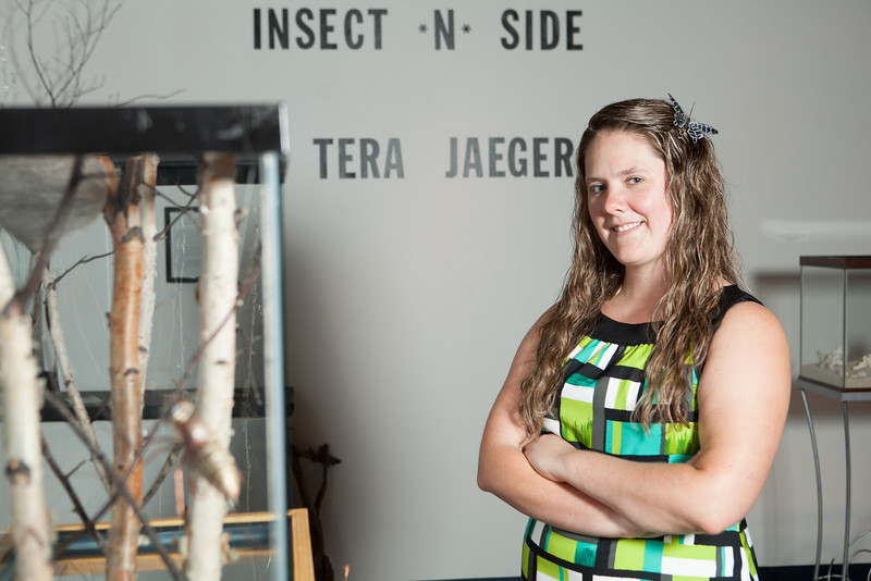 "Tera Jaeger poses for a photograph next to her favorite piece in ""Insect *N* Side,"" her Bachelor of Fine Arts Thesis Exhibition on Friday, October 5, 2012 at the Student Art Gallery.  <div class=""ss-paypal-button"">Filename: AAR-12-3580-68.jpg</div><div class=""ss-paypal-button-end"" style=""""></div>"